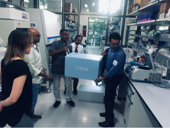 USCD graduate student Ember Tota hanging out with Nicoya's benchtop OpenSPR.